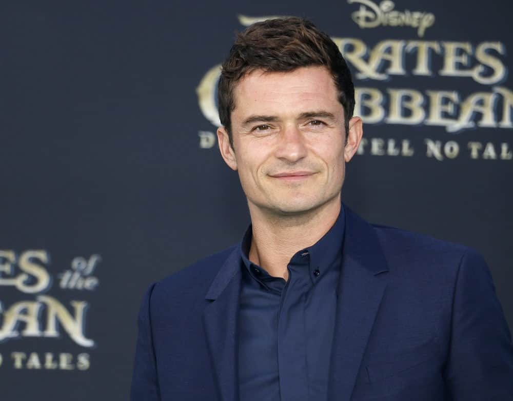 Orlando Bloom's dapper navy blue suit was a perfect pair for his short and spiky hairstyle that has subtle highlights at the premiere of 'Pirates Of The Caribbean: Dead Men Tell No Tales' in Hollywood on May 18, 2017.