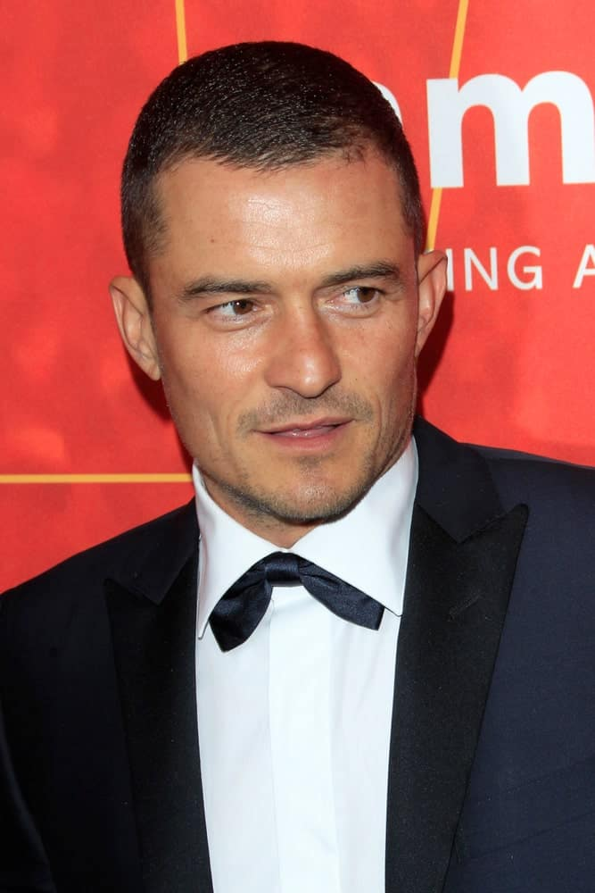 Orlando Bloom was at the 2018 amfAR Inspiration Gala at the Wallis Annenberg Center for the Performing Arts on October 18, 2018 in Beverly Hills, CA. His classy black suit was a nice complement to his buzz cut hairstyle and five o'clock shadow.