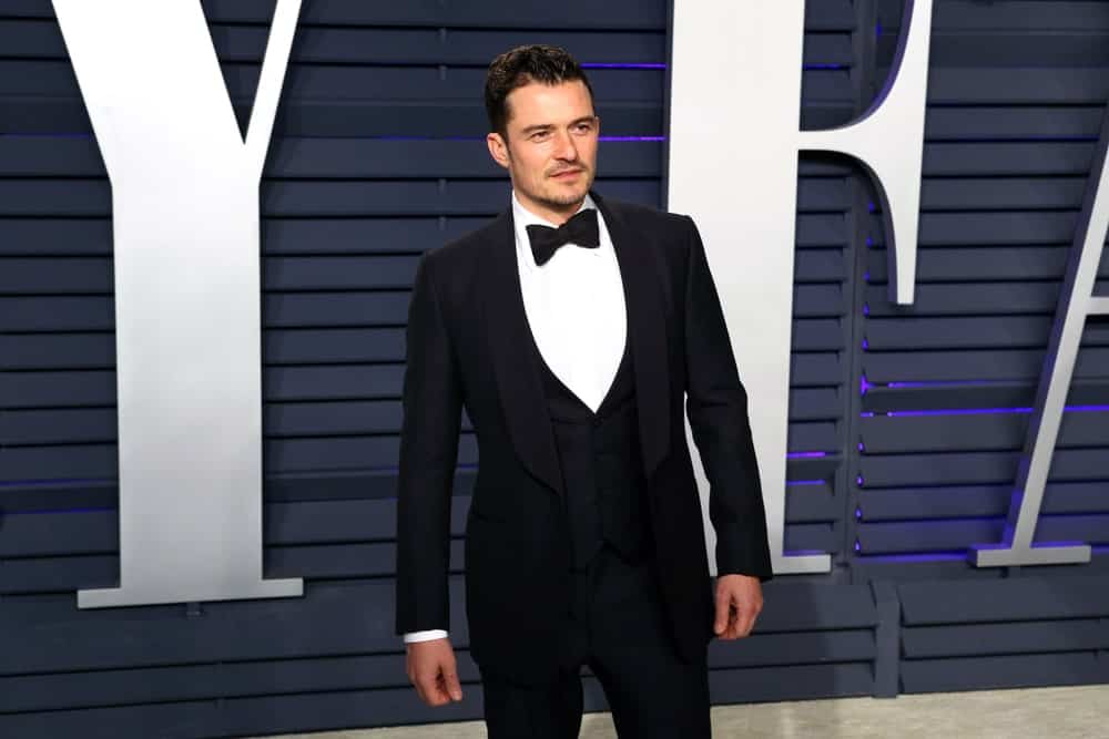 Orlando Bloom went for a classy look with his black tux and slicked back dark hair at the 2019 Vanity Fair Oscar Party at The Wallis Annenberg Center for the Performing Arts on February 24, 2019 in Beverly Hills, CA.