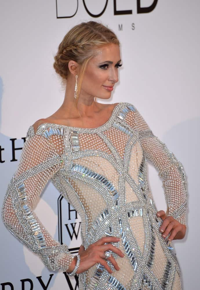 Paris Hilton exhibited a classy look with a glam upstyle incorporated with side french braids and tendrils during the amfAR Cinema Against AIDS Gala 2016 held on May 19th.