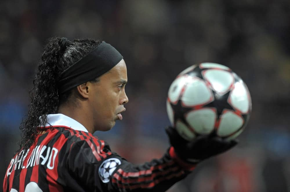 Brazilian player Ronaldinho holds the soccer ball during a UEFA Champions League match, in Milan.