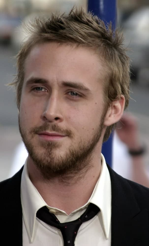 """Ryan Gosling attended the """"The Notebook"""" Los Angeles Premiere held at the Mann Village Theatre in Westwood, California on June 21 2004. He came with a classy black suit that he paired with a short spiky hairstyle."""