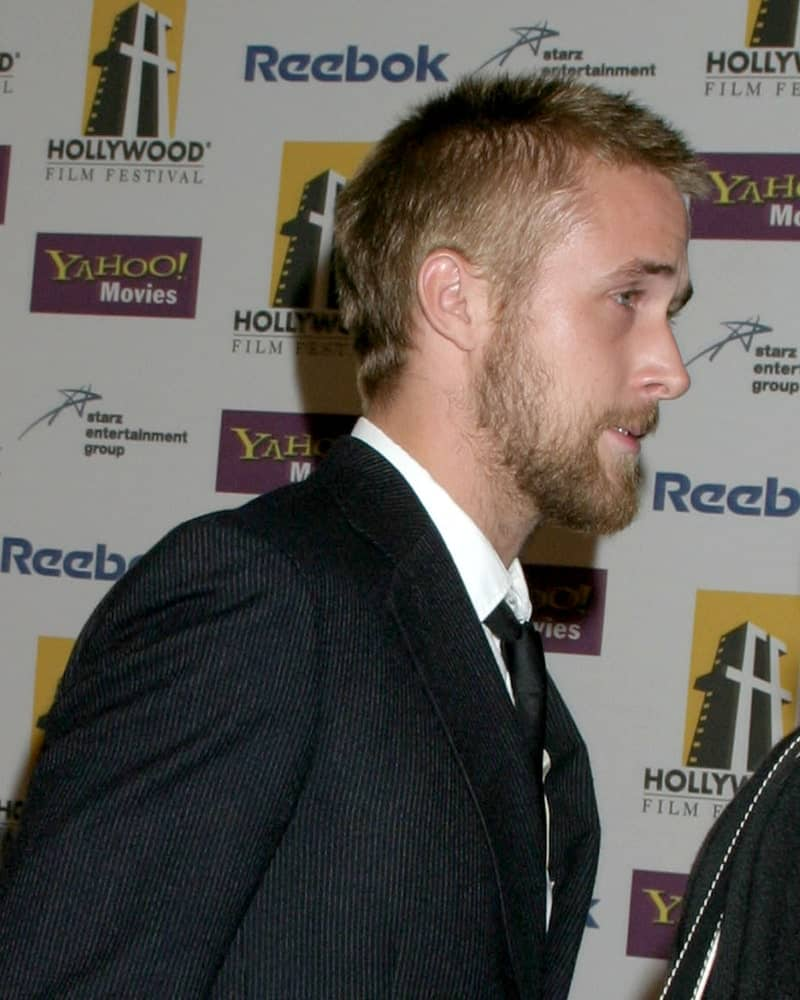 Ryan Gosling wore a dapper suit with his spiky buzz cut hairstyle and full scruffy beard at the Hollywood Film Festival Gala in Beverly Hilton Hotel on October 24, 2005 in Los Angeles, CA.