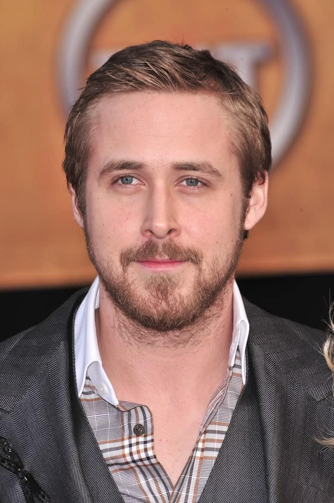 Ryan Gosling was at the 14th Annual Screen Actors Guild Awards at the Shrine Auditorium in Los Angeles on January 27, 2008. He wore a patterned gray suit with his short and spiked hairstyle.