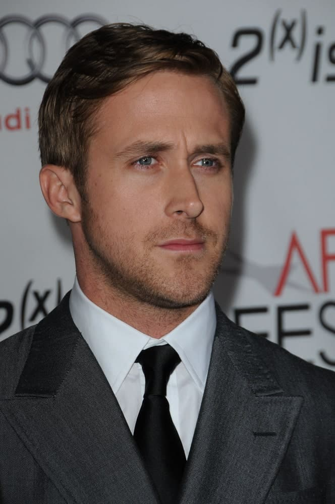 Ryan Gosling was very classy in his charcoal gray suit, trimmed beard and gorgeous side-parted hairstyle at the