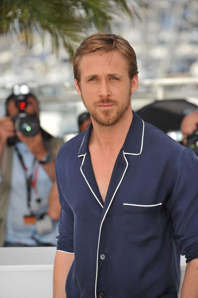 Ryan Gosling wore a fashion forward buttoned shirt with his side-parted and highlighted hairstyle at the photocall for his new movie