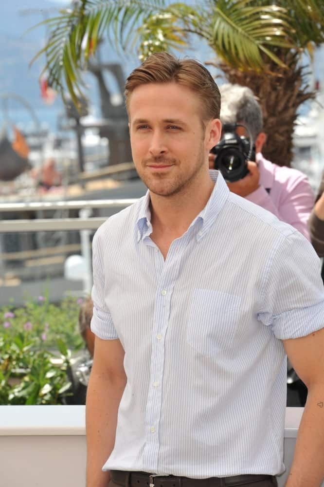 On May 20, 2014, Ryan Gosling's gorgeous side-parted hairstyle went well with his five o'clock shadow and light button'down shirt at the photocall for his movie