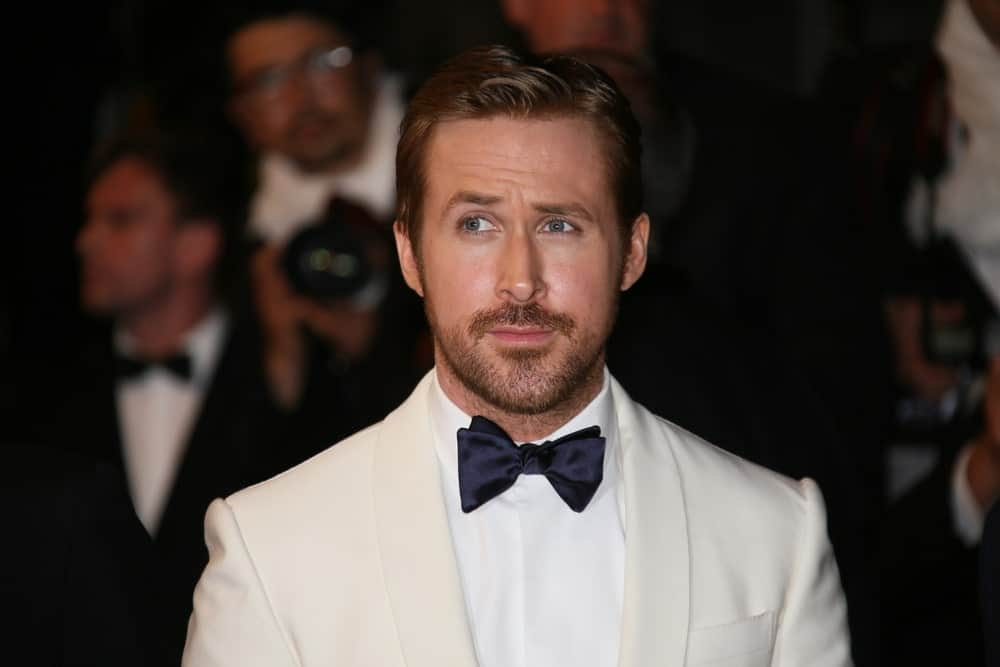 Ryan Gosling's vintage white suit and bow tie worked great with his trimmed beard and slick pompadour hairstyle at the 'The Nice Guys' premiere at the Palais des Festivals on May 15, 2016 in Cannes, France.