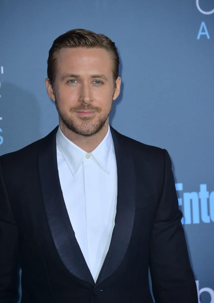 On December 11, 2016, Ryan Gosling attended the 22nd Annual Critics' Choice Awards at Barker Hangar, Santa Monica Airport. He wore a dapper black tux with his sexy slick side-parted pompadour hairstyle and confident smile.