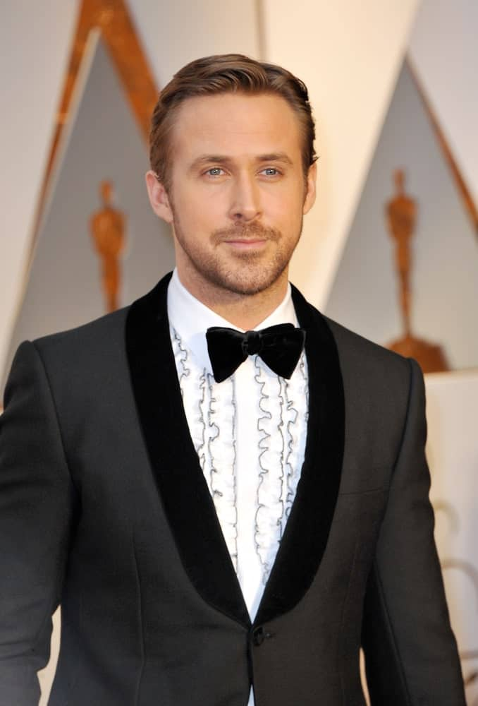 Ryan Gosling was handsome and sophisticated in his classy slicked side-parted hairstyle to go with his tux and tie at the 89th Annual Academy Awards held at the Hollywood and Highland Center in Hollywood on February 26, 2017.