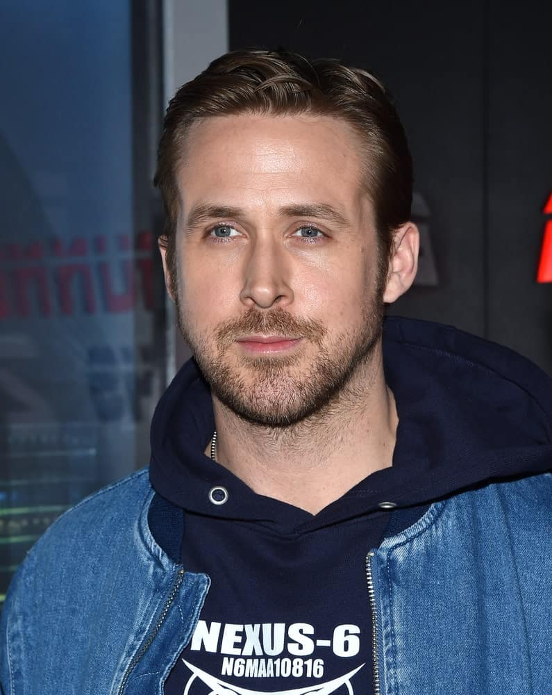 Ryan Gosling's slick dark hair was perfectly styled into a neat side-parted masterpiece that complemented his casual denim jacket and hoodie at the CinemaCon 2017-Sony Pictures on March 27, 2017 in Las Vegas.