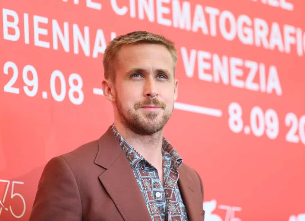 Actor Ryan Gosling's gorgeous Caesar fade hairstyle is a perfect pair for his tan suit when he attended the 'First Man' photocall during the 75th Venice Film Festival at Sala Casino on August 29, 2018 in Venice, Italy.