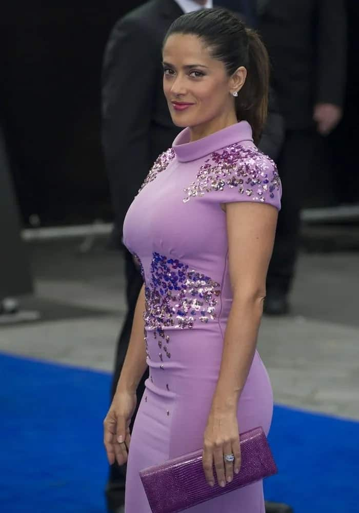 """Salma Hayek went for a slick and sophisticated high pony to complement her bright purple dress and confident smile for the World Premiere of """"Prometheus"""" at the Empire Cinema last May 31, 2012."""