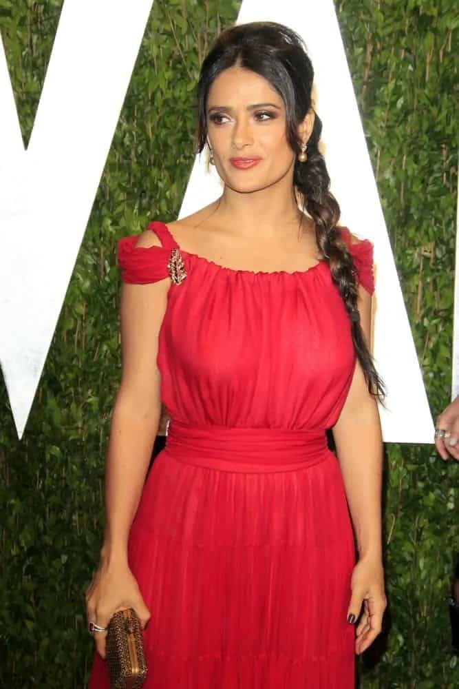 Salma Hayek was at the 2012 Vanity Fair Oscar Party last February 26, 2012. She stood out with her gorgeous red dress paired with a braided hairstyle for that simple yet elegant look.