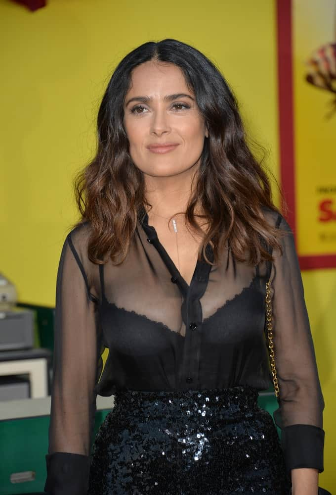 """Last August 9, 2016, the actress Salma Hayek was at the world premiere of """"Sausage Party"""" at the Regency Village Theatre in Westwood. She wore a sexy black sheer outfit to match her iconic wavy tousled hair."""