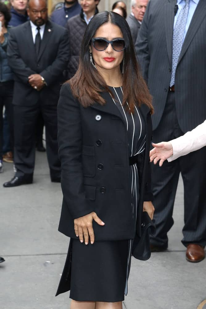 Salma Hayek was seen last April 21, 2017, in New York City. She was in a formal attire that goes quite well with her long highlighted hair that is parted in the middle.