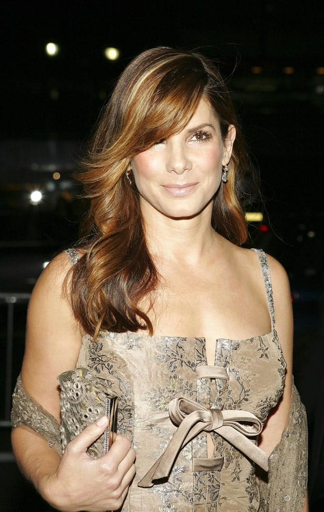 Sandra Bullock looked positively stunning in her floral dress and side-swept layered hairstyle with waves at the tips at The Fashion Group International's Night of Stars in New York last October 27, 2005.