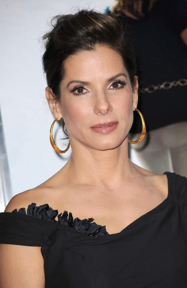 "Sandra Bullock was at ""The Blind Side"" November 17, 2009, Premiere in New York. Her simple black dress was complemented by her elegant neckline and slightly tousled elegant upstyle with highlights."