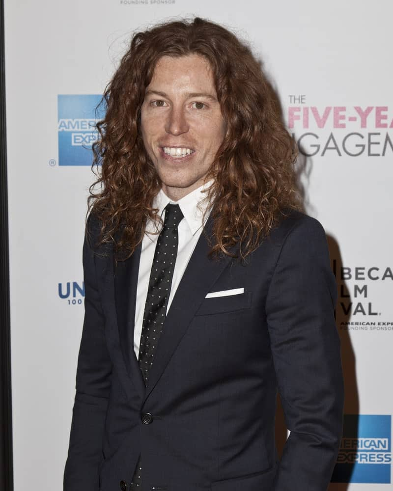 Shaun White with his long wavy hair in an elegant suit, spotted in in New York City attending the Five-Year Engagement premier on April 18, 2012.