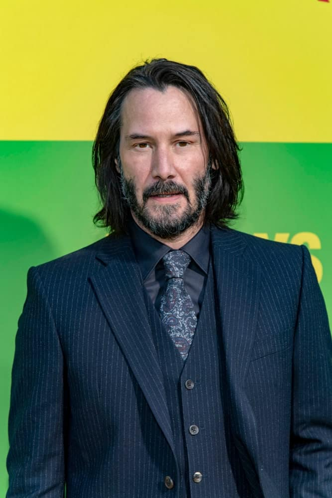 Keanu Reeves has been sporting the shoulder-length hairstyle for men for quite some time. Here he is, wearing his usual look at Netflix's