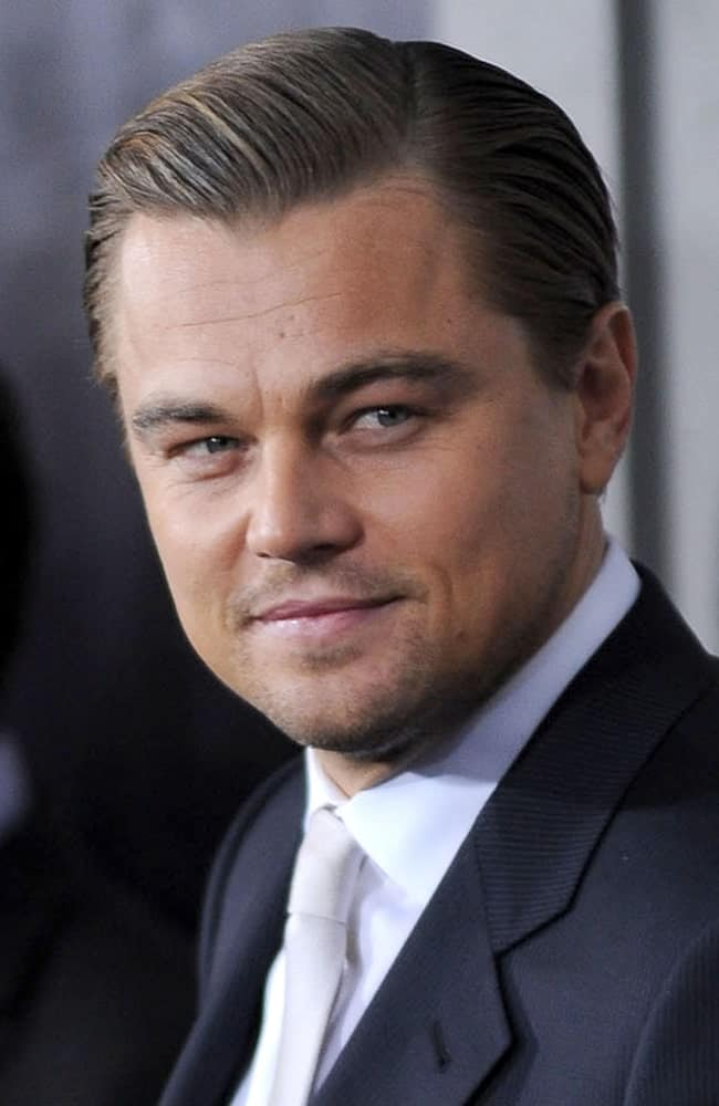 Photo of Leonardo Dicaprio at Shutter Island premier. He has a slicked back hairstyle.