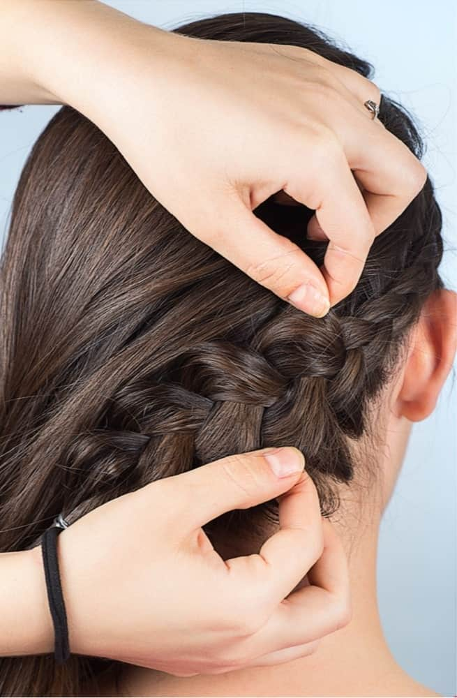 Step 5: Starting at the bottom, pull on both side of the french braid to loosen it and make it fuller