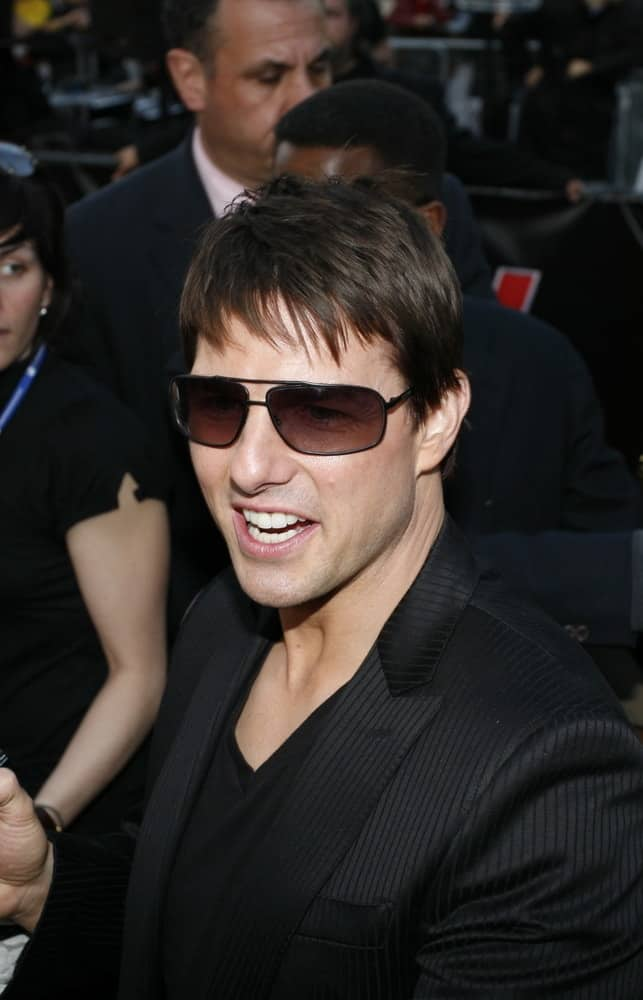 Tom Cruise with fringe bangs and shades.