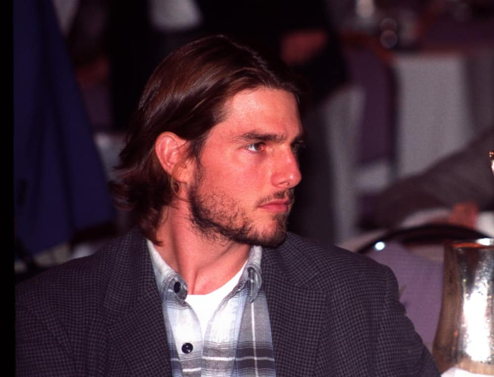 Tom Cruise was absolutely gorgeous with his long dark brown hair and trimmed beard back on July 14, 1992, outside The Forum arena in Los Angeles.