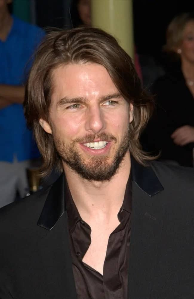 """Tom Cruise totally pulled off the shaggy layered medium-length hairstyle coupled with a trimmed beard for his 2002 film """"The Last Samurai."""""""