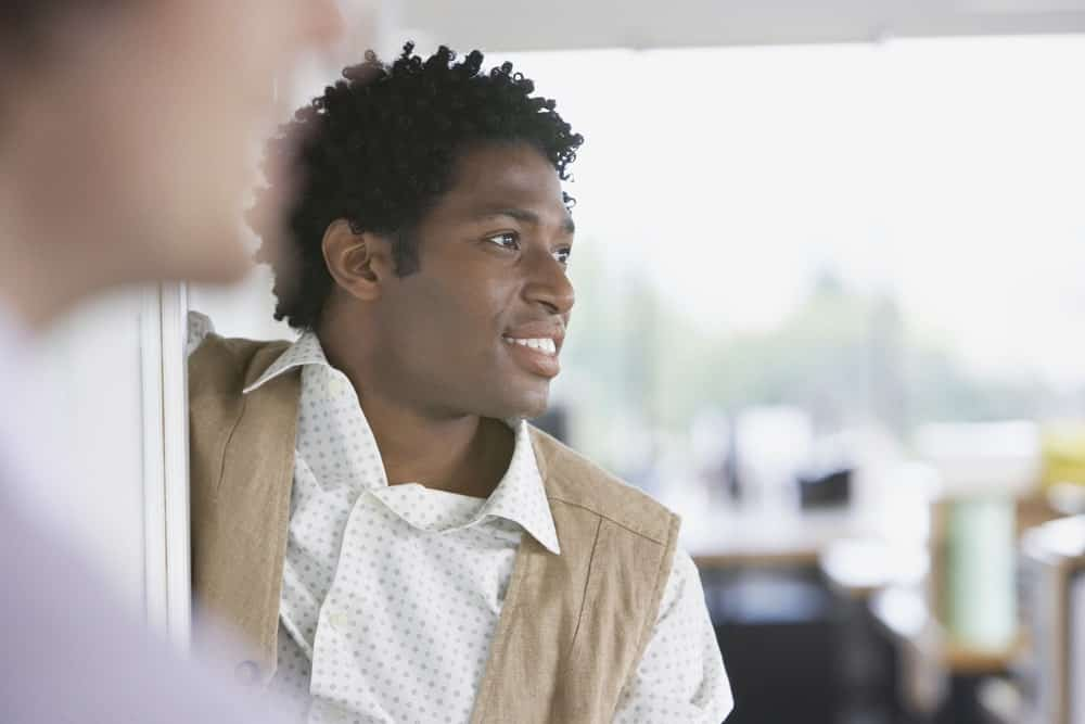 The twisted curls haircut is a great style for men with Afro-textured hair. Here's an African-American man sporting the look.