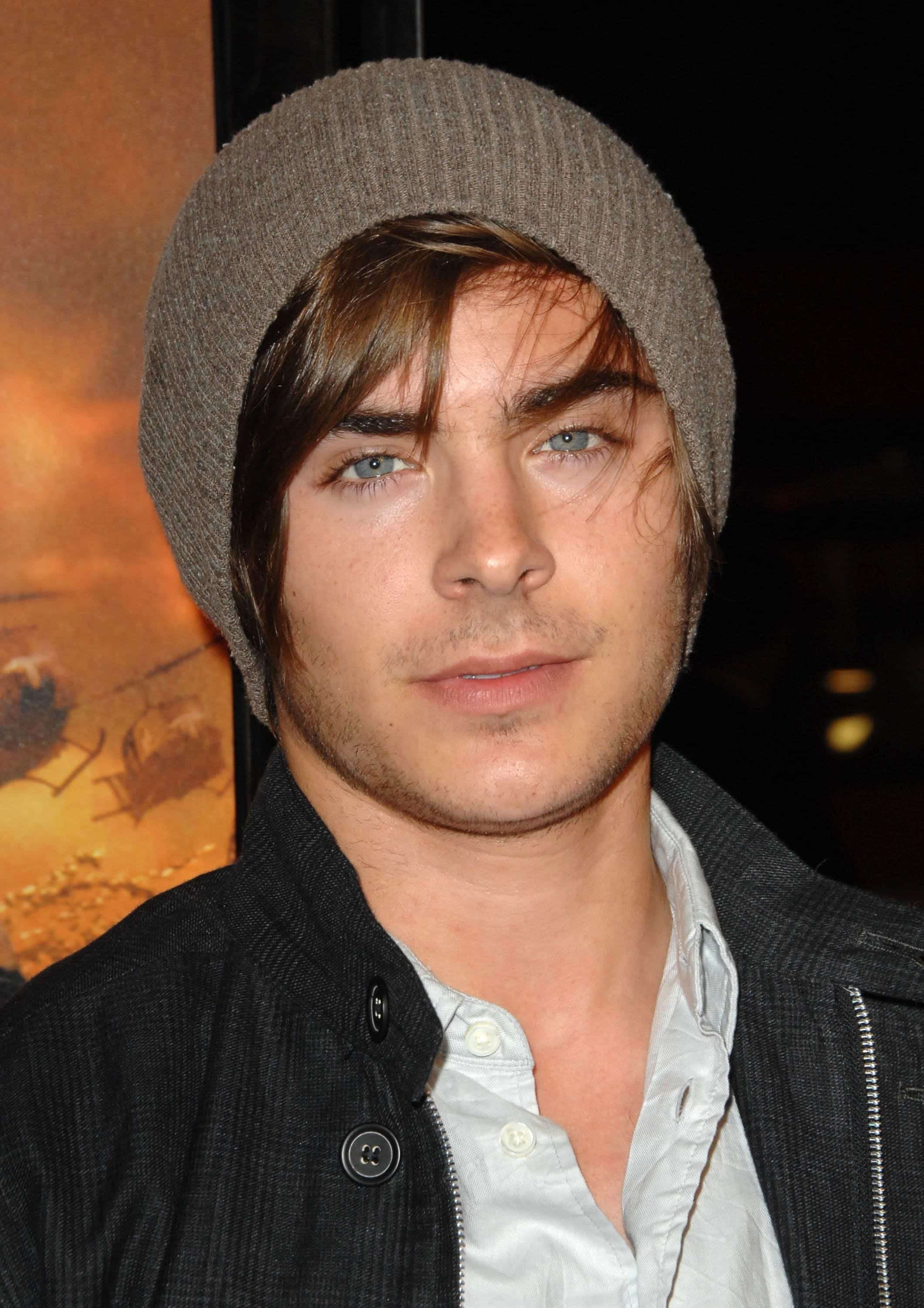 Zac Efron with a stylish outfit and a beanie bonnet covering his side-swept hairstyle. The photo was taken on March 2, 2009 at the Grauman's Chinese Theatre in Los Angeles, California.
