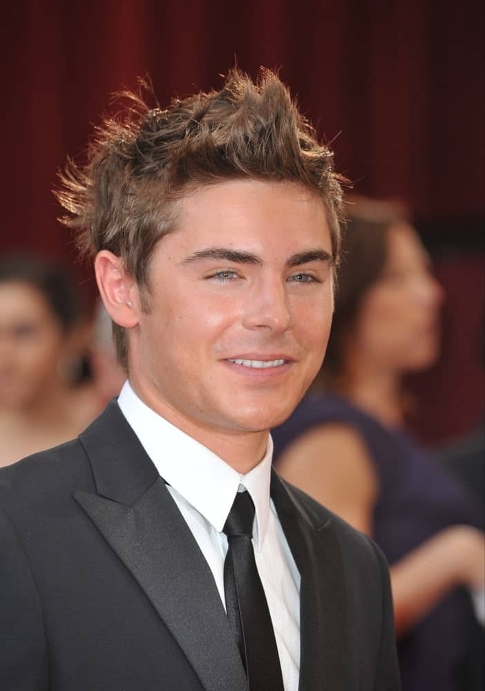 Zac Efron in a black suit, attending the 82nd Annual Academy Awards on March 7, 2010 at the Kodak Theatre, Hollywood.