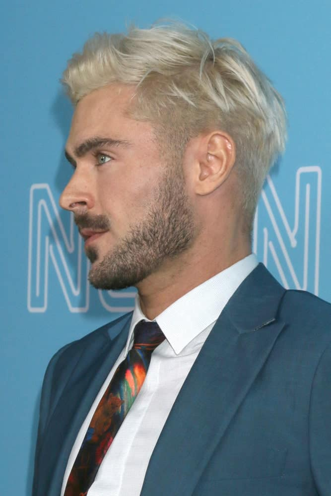 "Actor Zac Efron pulled off a fade haircut styled with frontal spikes during ""The Beach Bum"" Premiere at the ArcLight Hollywood on March 28, 2019."