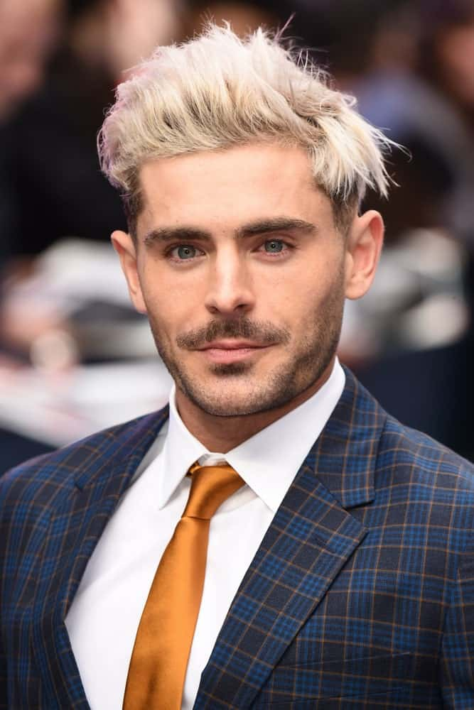 Zac Efron styled his platinum blond hair with a pompadour undercut during the