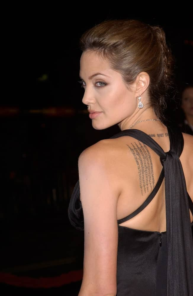 On November 16, 2004, Actress Angelina Jolie shows her fierce pose with a black dress and slicked back upstyle hair at the world premiere, in Hollywood, of her new movie Alexander.