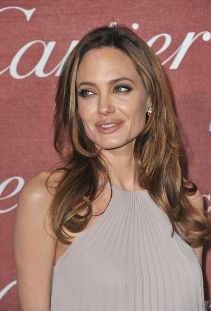 Angelina Jolie was the envy of everyone with her sexy chiseled face and long layered waves with highlights at the 2012 Palm Springs Film Festival Awards Gala at the Palm Springs Convention Centre on January 7, 2012, in Palm Springs, CA.