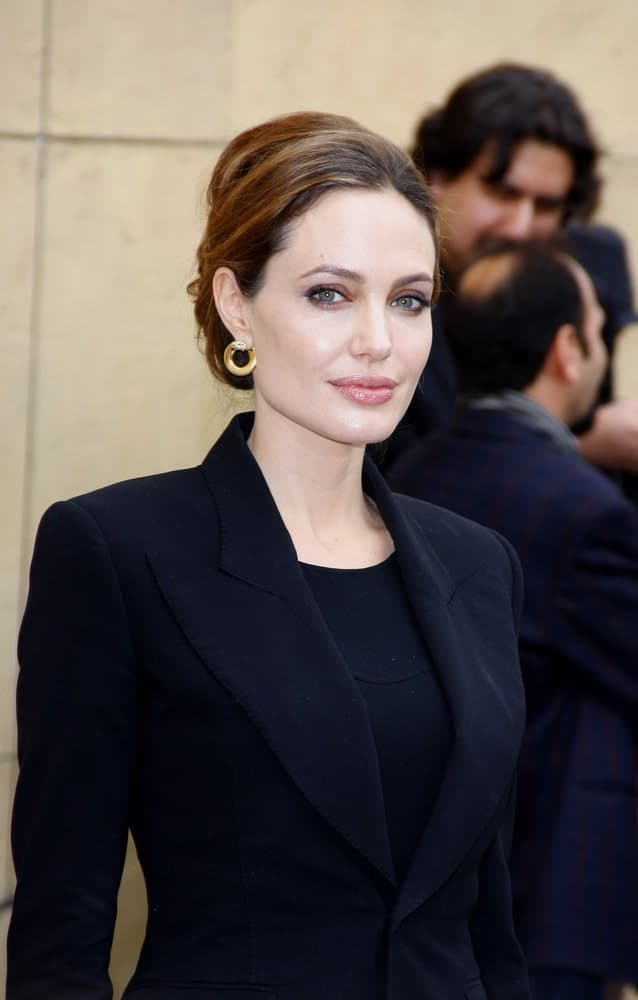 Angelina Jolie attended the 2012 Golden Globe Foreign Language Film Panel Discussion held at the Egyptian Theatre in Hollywood, USA on January 14, 2012. She wore a black smart casual outfit to pair with her bun hairstyle that has subtle highlights.