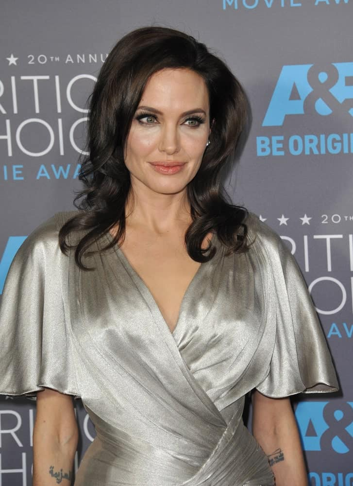On January 15, 2015, Angelina Jolie paired her elegant and stylish silver dress with a tousled dark hairstyle with curls at the tips at the 20th Annual Critics' Choice Movie Awards at the Hollywood Palladium.