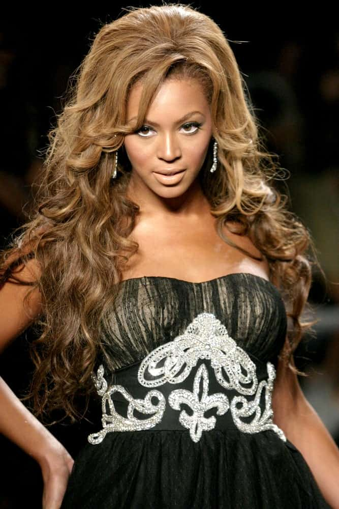 Beyonce incorporates her slicked-back waves with long curtain bangs at the Fashion For Relief at Bryant Park, New York, NY held on September 16, 2005.