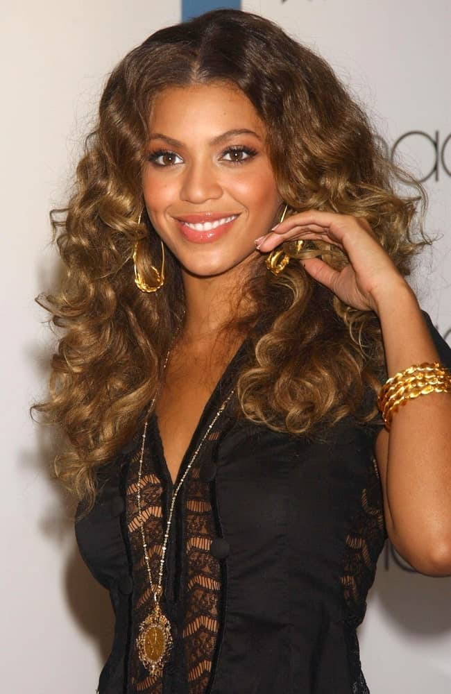 Beyonce Knowles during an in-store appearance for Beyonce Knowles Releases Solo Album B'DAY on September 8, 2006. She wore a lacy black dress and a center-parted curly hairstyle.