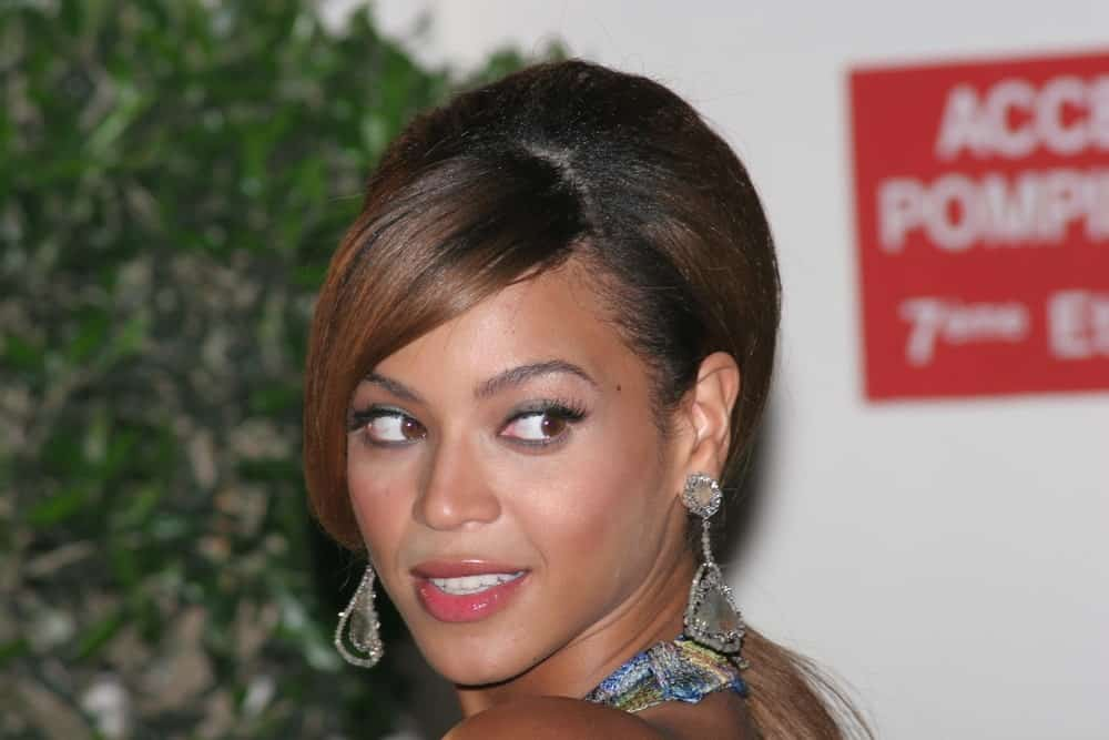 Beyonce Knowles arrived for the 'Dreamgirls' premiere at the Martinez Hotel during the 59th International Cannes Film Festival on May 19, 2006. She pulled off a glam updo that's incorporated with long side-swept bangs.