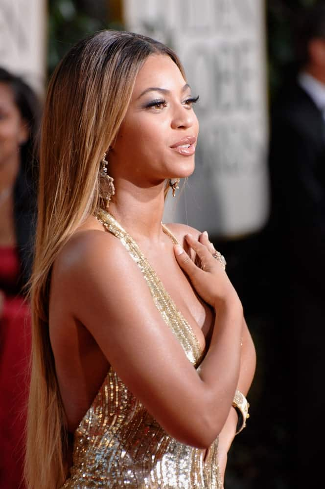 Beyonce matched her stunning gold gown with a long straight center-parted hairstyle at the 64th Annual Golden Globe Awards held at the Beverly Hilton Hotel on January 15, 2007.