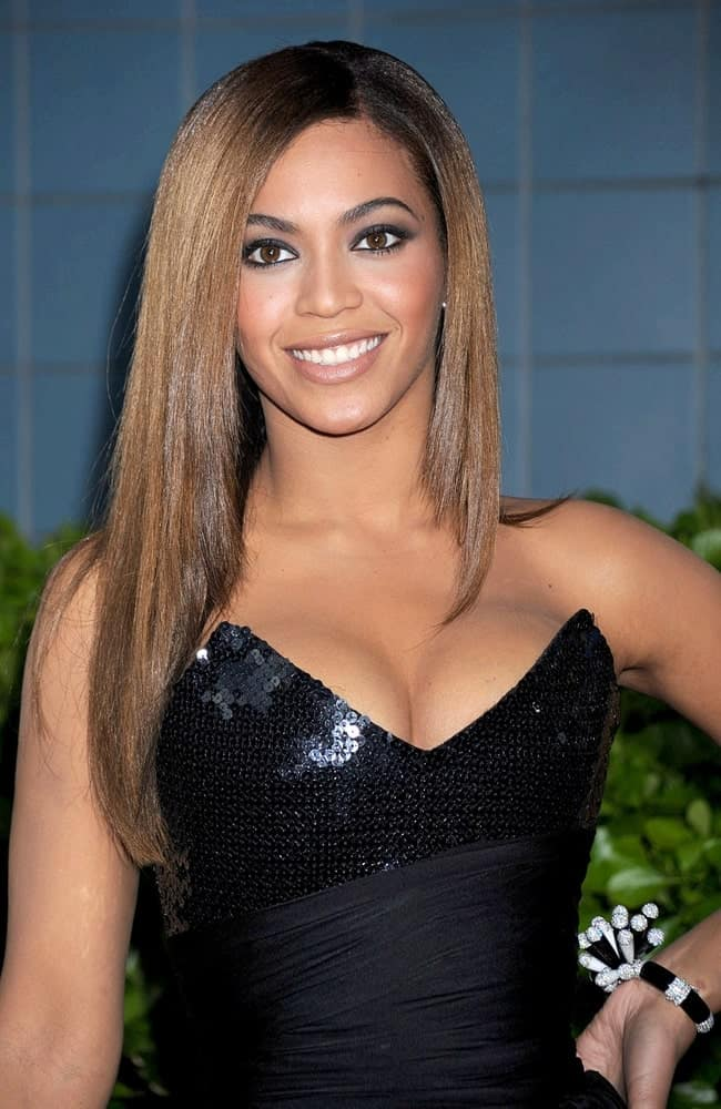 "Beyonce wearing a black Balmain dress during the Cinema Society and MCM screening of her movie ""Obsessed"" held on April 23, 2009. She paired it with her straight side-parted locks styled with subtle layers and shadow roots."