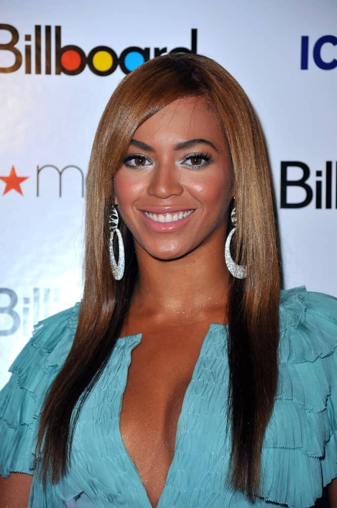 On October 2, 2009, Beyonce Knowles wore a blue ruffled dress along with a sleek straight side-parted hairstyle at Billboard's Women in Music Brunch, The Pierre Hotel, New York, NY.