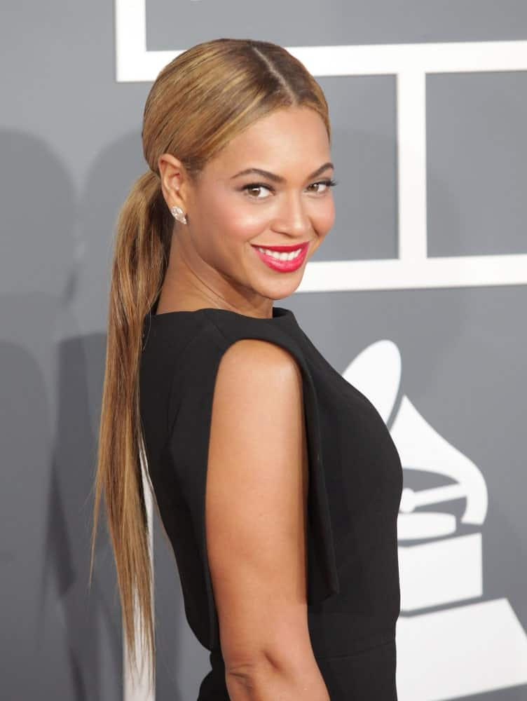 Beyonce Knowles went for a low ponytail with middle parting during the 2013 Grammy Awards on February 10, 2013, in Hollywood, CA. She finished the look with red lipstick and a classic black dress.