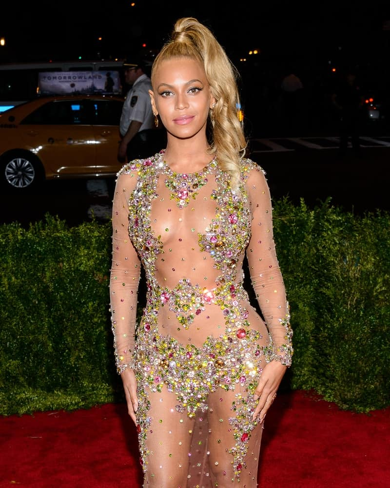 Beyonce attends the 'China: Through The Looking Glass' Costume Institute Gala on May 4, 2015, in a daring sheer Givenchy gown with candy-colored gemstones and a super top high ponytail that let her look appears to have an extraordinary elegance. All eyes were on her!