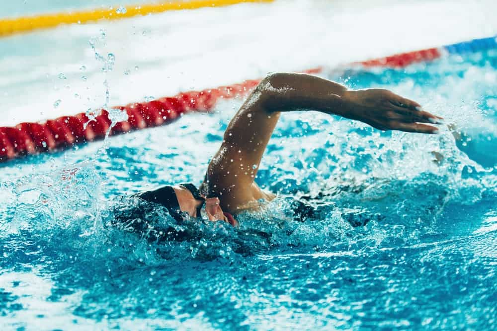 An athlete swimming toward the finish line.