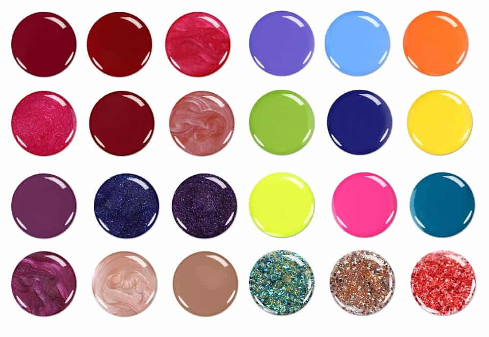 A variety of nail polish sample swatches on a white background.