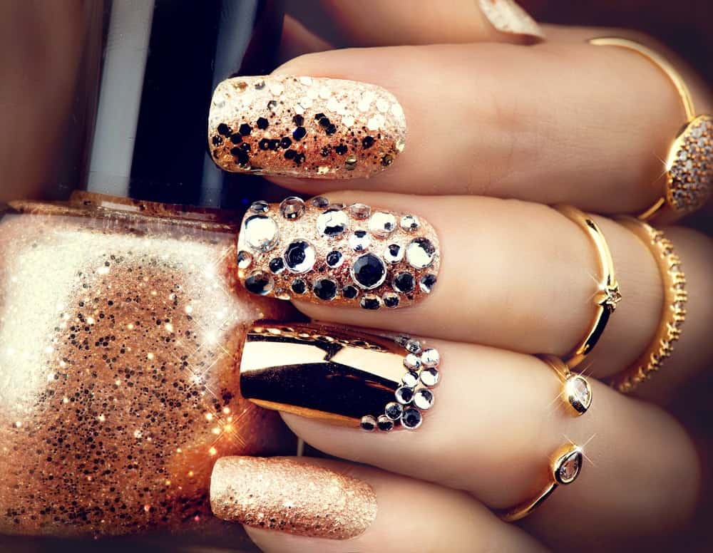 Gold bejeweled nail polish art.