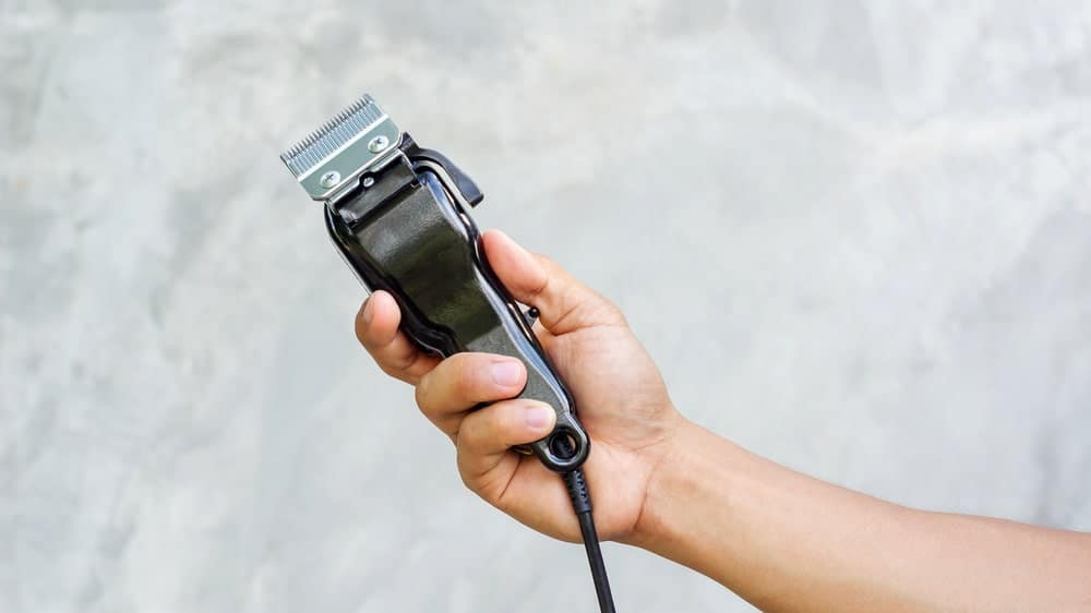 A man holding a hair clipper.